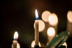 Free Many Burning Church Wax Yellow Candles In Large On A Special Stand Royalty Free Stock Image - 150974966
