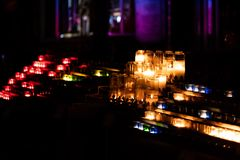 Many burning colourful candles stock image
