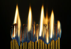 Many burning matches against black background Royalty Free Stock Photography