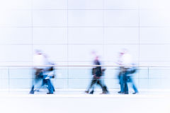 Many business people in blurred motion Stock Photos