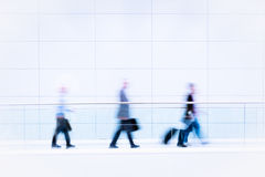 Many business people in blurred motion Stock Photography