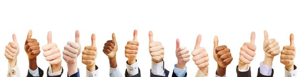 Many business people show thumbs up stock images