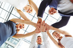 Many business people stacking their hands royalty free stock photography