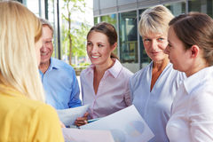 Many business people talking to each other Stock Image