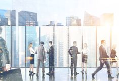 Business people in their office lobby, city sun Royalty Free Stock Photography