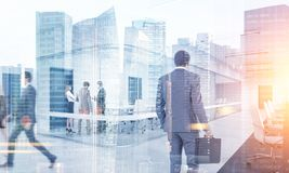 Business people walking in a modern city. Many business people walking, talking and going to their workplace in a modern city. Toned image double exposure mock stock photo