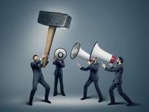 Many businessmen with huge megaphones Stock Image