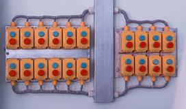 Many buttons located on the wall in a modern factory, close-up, control panel, production stock images