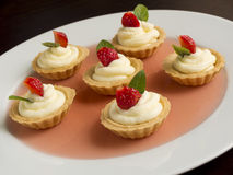 Many cakes, cupcakes with fresh fruits (strawberries), whipped cream, jelly and mints Royalty Free Stock Image