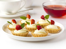 Many cakes, cupcakes with fresh fruits, whipped cream, jelly and mints Stock Photography