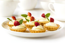 Many cakes, cupcakes with fresh fruits, whipped cream, jelly and mints Royalty Free Stock Images