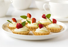 Many cakes or mini tart with fresh fruits, whipped cream and mints Royalty Free Stock Photo