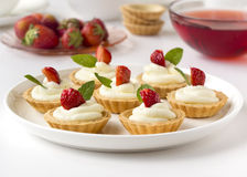 Many cakes with whipped cream, fresh fruits and mints. Many cakes, cupcakes with whipped cream, fresh fruits and mints Royalty Free Stock Photography