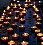 many candles in a church for the prayers of the faithful Royalty Free Stock Image