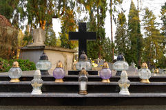 Many candles on the grave Royalty Free Stock Images