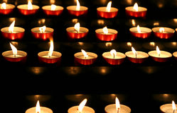 many candles lit inside the place of worship to pray Royalty Free Stock Photo