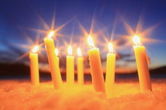 Many candles sticking snow burning Royalty Free Stock Photo