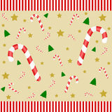 Many candy canes on a golden background Royalty Free Stock Images