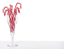 Many Candy canes in a wine glass Royalty Free Stock Photos