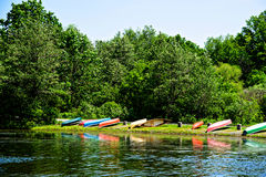 Many Canoes Across a Lake. Many colorful canoes across a lake in summer time Royalty Free Stock Photo