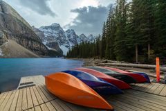 Many Canoes on wooden deck at Moraine lake in Banff national park stock images