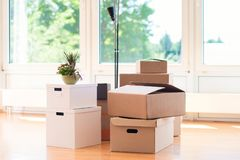 Many cardboard boxes in bright house during relocation. Many cardboard boxes in big bright house during relocation royalty free stock image