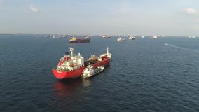 Many cargo ships sailing in the sea in sunny weather on blue sky background. Shot. Barges moving in the waterways of