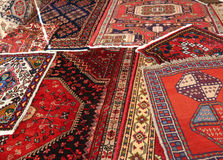 Many carpets of different quality on sale in the market. Carpets of different nationalities and quality on sale in the market Stock Images