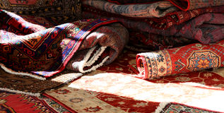 Many carpets of different quality on sale in the market. Carpets of different nationalities and quality on sale in the market Royalty Free Stock Photos