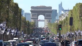 Many cars busy crowded traffic under Arc de Triomphe, Arch of Triumph in Paris. UHD 4K stock video