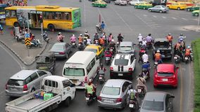 Many cars on the crossroads in Bangkok, Thailand. THAILAND, BANGKOK, APRIL 11, 2014: Road traffic near Victory Monument in Bangkok, Thailand. Many cars on the stock footage