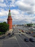Many cars drive along the Moscow river, by Moscow Kremlin walls. Stock Photo