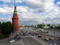 Many cars drive along the Moscow river, by Moscow Kremlin walls. Stock Photography