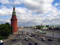 Many cars drive along the Moscow river, by Moscow Kremlin walls. Royalty Free Stock Photos