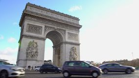 Many cars driving by Arc de Triomphe in sunlit Place Charles de Gaulle in Paris. Stock footage stock footage