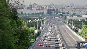 Many cars go on the city highway