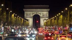 Many cars on night crowded street of Arc de Triomphe, Arch of Triumph Paris city lights. UHD 4K stock video