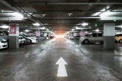 Many cars in parking garage interior, industrial building. Vinta Stock Photos