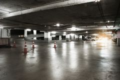 Many cars in parking garage interior, industrial building. Vinta Stock Image