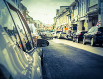 Many cars parking on the road in old town of phuket. Many cars parking on the road under sunlight in old town of phuket, Thailand Stock Images