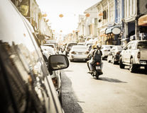 Many cars parking on the road in old town of phuket. Many cars parking on the road under sunlight in old town of phuket, Thailand Royalty Free Stock Photography