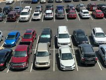 Many cars at a parking and a viewed from above. stock images