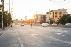 Many cars on the road. Many car on the road and beautiful sunrise Stock Image