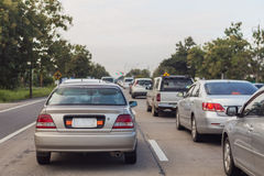 Many cars on the road. Many car jam on the road stock photography
