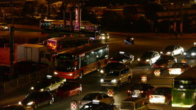 Many cars on road,traffic jam at night,crossroads,junctions.