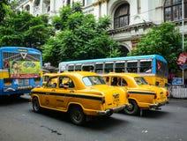 Many cars run on street in Kolkata, India Stock Photo