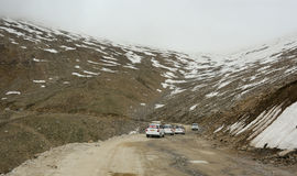 Many cars running on the snow road in Jammu, India Royalty Free Stock Image