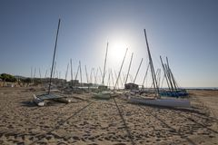 Many catamarans in the sun on the beach in Benicassim. Many catamarans in the sun on the beach Els Terrers, in Benicassim, Castellon, Valencia, Spain, Europe Royalty Free Stock Photography
