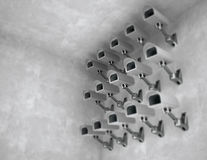 Many CCTV cameras on the wall Stock Photo