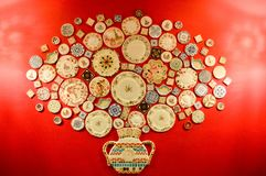 many ceramic plates on a red wall, background Stock Images